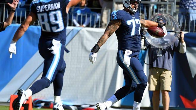 Titans tackle Taylor Lewan (77) celebrates after a touchdown reception Sunday.