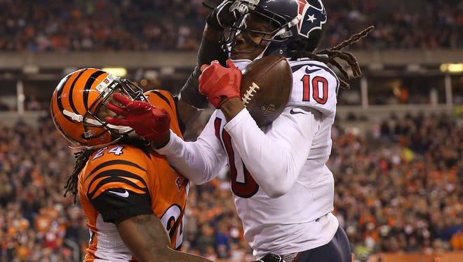 Houston Texans wide receiver DeAndre Hopkins (10), right, catches a touchdown pass as Cincinnati Bengals cornerback Adam Jones (24) defends in the fourth quarter during the Week 10 NFL football game between the Houston Texans and the Cincinnati Bengals, Monday, Nov. 16, 2015, at Paul Brown Stadium in Cincinnati. The Texans won 10-6.