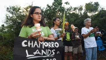 Residents hold candlelight vigil for Ritidian
