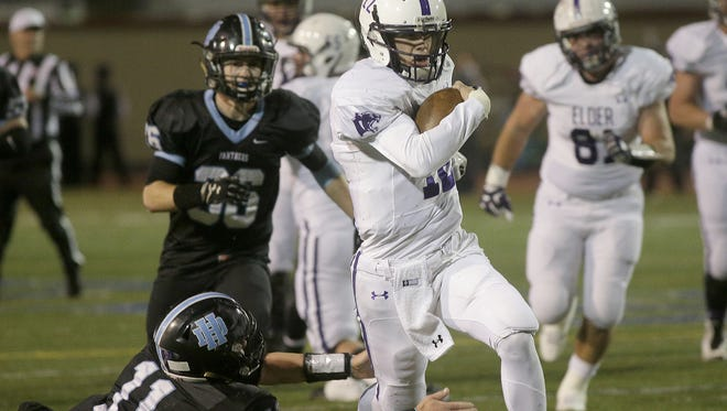 Peyton Ramsey runs the ball for the Panthers during their football game against Hilliard Darby, Saturday, Nov. 14, 2015.