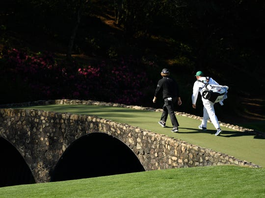 William McGirt walks across the Hogan Bridge during the second round of The Masters golf tournament at Augusta National Golf Club.