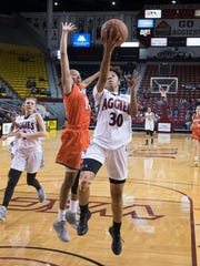 Aggies Gia Pack finishes the fast break with pressure form UTRGV's Shawnte' Goff Saturday afternoon at the Pan American Center, 2/18/17