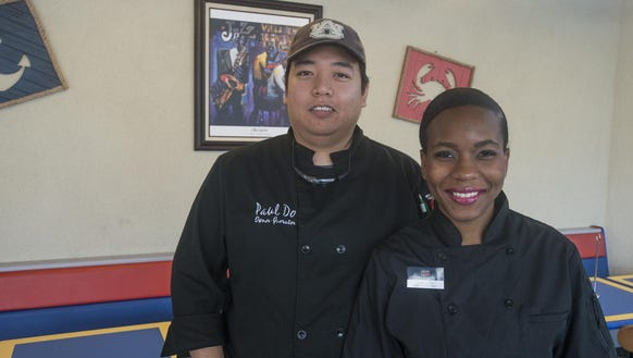 Paul and Jessica Do at the Seafood Bistro on Woodmere. They'll be moving to Perry Hill Plaza next year.