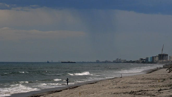 A view of storm clouds over the south beaches of the Space Coast as seen from across Patrick Air Force Base on Tuesday.
