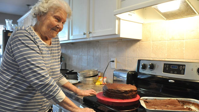 Dorothy Borden, 94, looks over the two versions of Best Chocolate Cake - one a gluten-free - she made with the assistance of rehab therapists at Wisteria Place on Feb. 1.