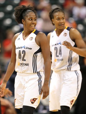 Fever guard Shenise Johnson, left, and teammate Tamika Catchings are all smiles after defeating Connecticut 83-70 at Bankers Life Fieldhouse on Sunday, August 2, 2015.