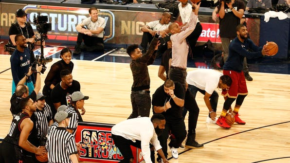 Feb 18, 2017; New Orleans, LA, USA; Celebrities and NBA players try to make baskets to raise money for the Sager Strong Foundation in the three-point contest during NBA All-Star Saturday Night at Smoothie King Center. Mandatory Credit: Derick E. Hingle-USA TODAY Sports ORG XMIT: USATSI-357225 ORIG FILE ID:  20170218_pjc_ah6_244.JPG