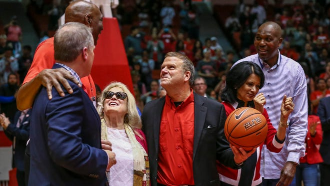 Businessman and University of Houston board of regents chairman Tilman Fertitta (middle) holds the ceremonial final ball at Hofheinz Pavilion after a game between the Houston Cougars and the East Carolina Pirates.