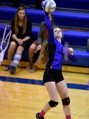 Baltic's Ashlee Hartman spikes the ball against Alcester-Hudson