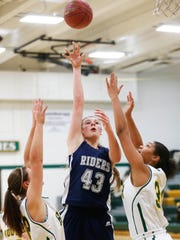 Roosevelt's Grace Cumming (43) gets the layup over a pair of Hoover defenders Friday, Dec. 16, 2016, at Hoover High School in Des Moines.