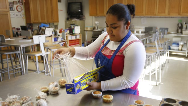 In 2009, Mariel Rosales, then 17, worked at her student aid job at Mission Trails ROP in Salinas. She took a class there for two hours, then worked for two hours, cleaning the kitchen area, selling food and answering students' questions.  Photo taken on 3/12/09 in Salinas. Photo by Scott MacDonald 0312_SUMMERJOBS_8604  Camera data: 3/12/09 at 2:16:42 PM, ISO 400, 1/200 @ f/2.8, WB=Auto, 23mm, , Fine, frame 8604.