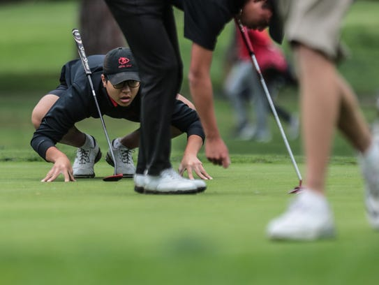 Palm Desert's John Kim prepares to putt on 14 during