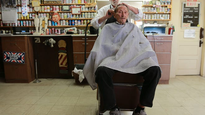 Traditional barber Bill Owens cut regular customer Don Ferris' hair Wednesday at the Parkland Barber Shop at 10115 Dyer in northeast El Paso.
