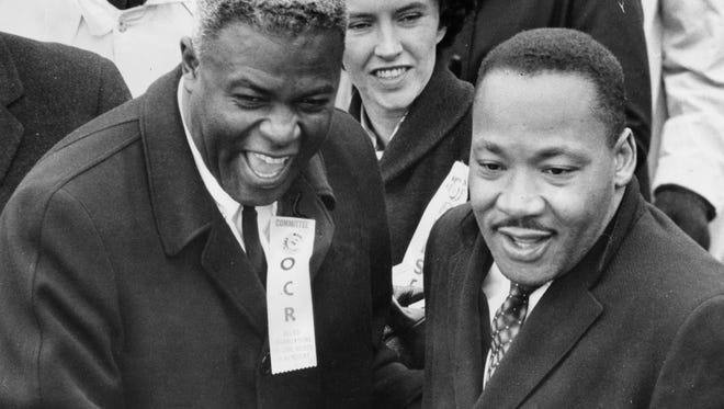 "Jackie Robinson wore an ""Organization for Civil Rights"" badge when he took part in a Louisville march with Dr. Martin Luther King in 1964. 