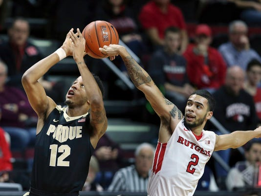 Rutgers guard Bishop Daniels (2) blocks a shot by Purdue forward Vince Edwards (12) during the first half of an NCAA college basketball game, Monday, Jan. 18, 2016, in Piscataway, N.J. (AP Photo/Mel Evans)