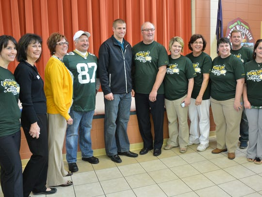 Staff members pose with their Packers visitor – from left, Amber Binney, Karen Doster of WMMB, Karen Treml, John Pagel, Jordy Nelson, Joe Innis, Tracy Ledvina, Sheree Malvitz, Kim Dax, Jason Karnopp and Joyce Tyeptanar.