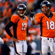 DENVER, CO - AUGUST 23:  Peyton Manning (18) and Brock Osweiler (17) of the Denver Broncos warm up before the start of a preseason football game at Sports Authority Field at Mile High on Saturday, August 23, 2014 in Denver, Colorado.  (Photo by Steve Nehf/The Denver Post via Getty Images)