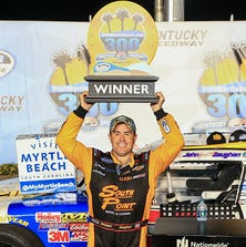 Brendan Gaughan, driver of the #62 South Point Chevrolet, celebrates in victory lane after winning the NASCAR Nationwide Series VisitMyrtleBeach.com 300 at Kentucky Speedway on September 20, 2014 in Sparta, Kentucky.