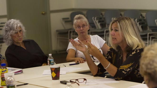 Kathy Holahan leads a support group for grandparents who are the primary caregivers for their grandchildren at the Center for Healthy Living in Lakewood, N.J.