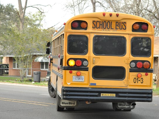 Rapides Parish school buses drop off children after