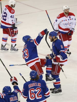 Rangers celebrate their game winning goal in overtime against the Capitals in Game 7 at Madison Square Garden Wednesday.