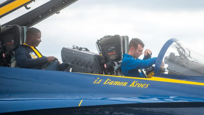 U.S. Navy Petty Officer Arthur Stockpole, Seven crew chief, and Lt. Brandon Hempler exit the Blue Angels F/A-18 Hornet No. 2 jet for a short meet and greet at the Millville Airport on Wednesday, May 24.