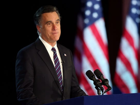 Mitt Romney concedes the presidency to Barack Obama