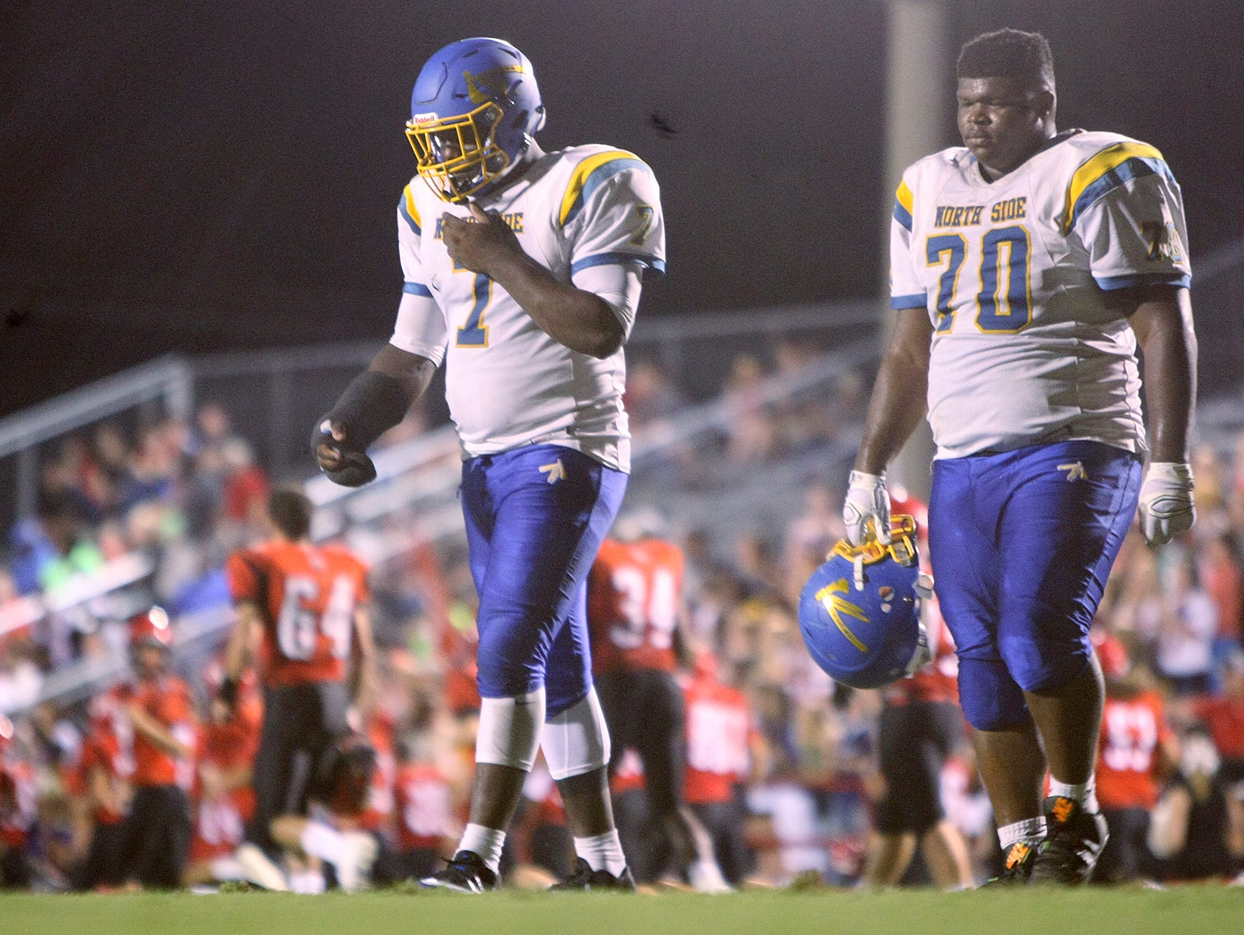 North Side's Greg Emerson (7) and Kevin Albea (70) walk off the field after the first half against Lexington at Jim Stowe Field in Lexington, Tenn., on Friday, Sept. 16, 2016.
