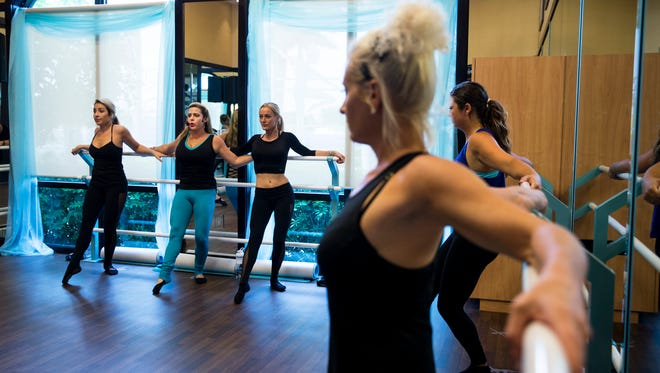 Michelle Price-Fawcett, 31, second from left, leads the TriTone class at the Naples Bay Club on Wednesday, April 12, 2017. TriTone is a posture-perfecting, low-impact workout that tones the body and teaches classic dance movements in a technique called Rhythmic Fitness.