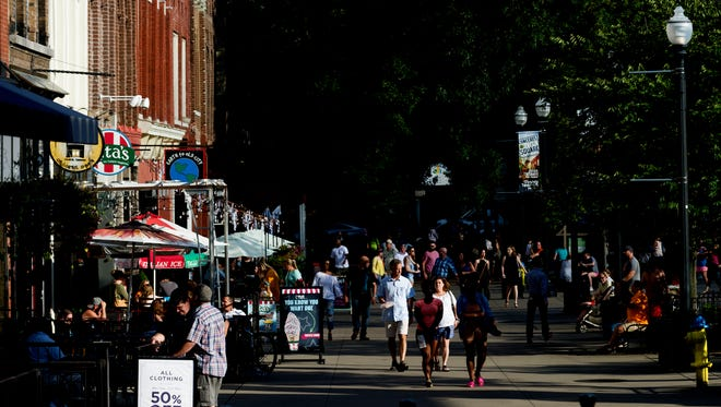 People walk through Market Square in Knoxville, Tennessee on Aug. 12, 2017.
