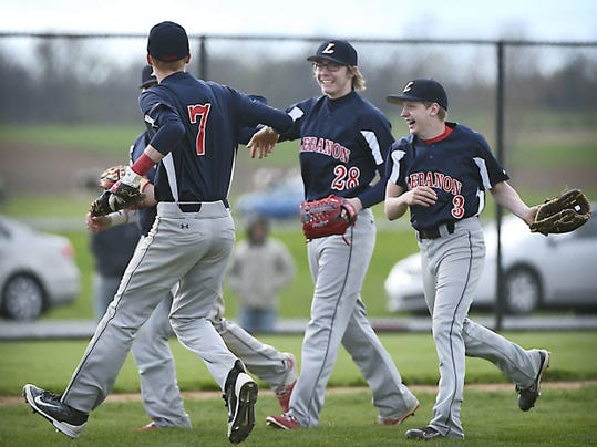 Lebanon's Logan Blouch (7), Cody Kissinger (28) and Austyn Yerger (3) celebrate after defeating Elco, 3-2, on the road Monday at Lyle Krall Field.