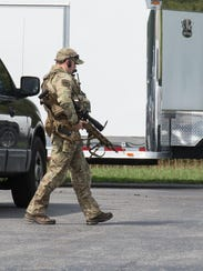 A Maryland State Police sharpshooter moves toward a