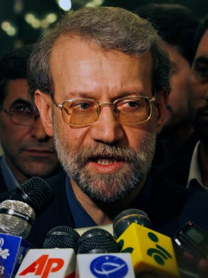 Iran's parliament speaker Ali Larijani, former top nuclear negotiator, talks to the media as he leaves the parliament in Tehran, Iran, Sunday, June 1, 2008.