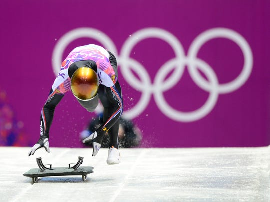 John Daly competes in the second heat of men's skeleton