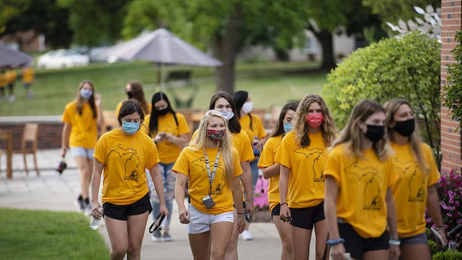 Students are pictured on the campus of Adrian College. The college reported Thursday that its enrollment for the 2020-21 school year has set a new record high.