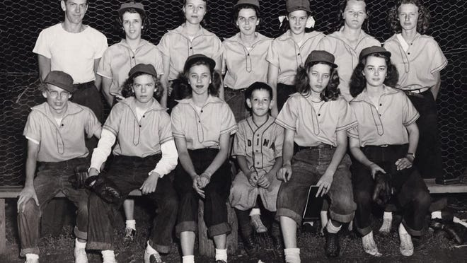 The photo shows the 1948 Kewanee Merchanettes, the original Kewanee Ballhawks. They were high school girls who formed a traveling team under the leadership of Grace Larson that in 1951 became known as the Kewanee Ballhawks. Team members with maiden names were, front row from left: Dorothy (Dot) Larson, Frances Olson, Wilma Fulton, Charlie Hainline (bat boy brother of Joanne), Charlene Marvin, Jerrie Hetherington. Back row: Stan Douglas (manager), Ruth Skeeters, Beverly Brockman, Mary Lou Reed, Joanne Hainline, Marilyn Anderson and Jean LaRue.
