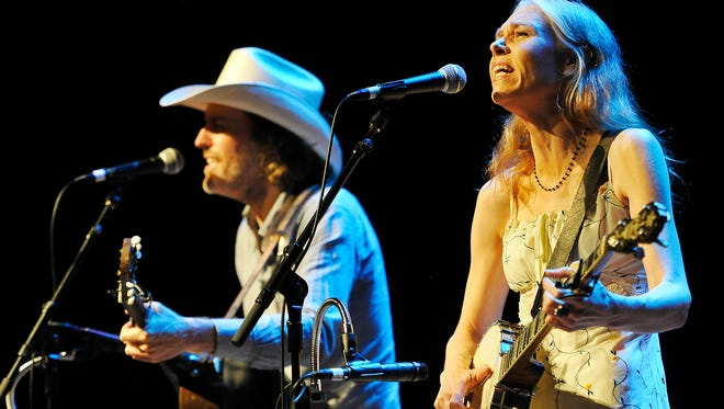 Gillian Welch with her musical partner, guitarist David Rawlings as they perform in concert at theFranklin TheatreTuesday Aug. 11, 2015, in Franklin, Tenn.