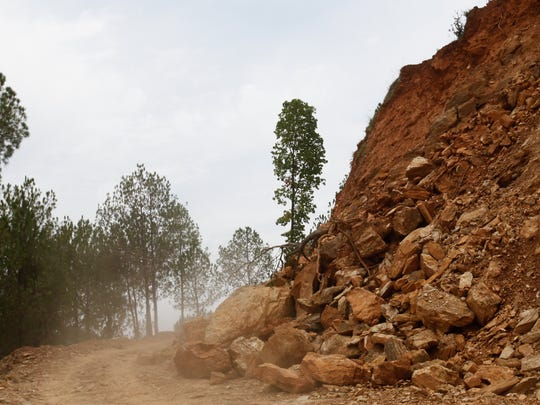 A rock slide blocks half of the road on the way to Katunge.