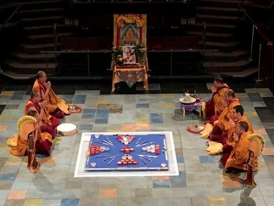 Drepung Gomang monks work on creating their sand mandala
