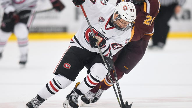 St. Cloud State's Blake Lizotte tries to steal the puck against the University of Minnesota Saturday, Jan. 6, at the Herb Brooks National Hockey Center.