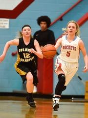 Ridgedale's Madison Staton races the ball up the floor against Colonel Crawford last season.