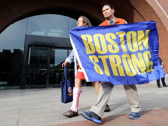"Boston Marathon bombing volunteer first responder Carlos Arredondo holds a ""Boston Strong"" banner as he leaves the Moakley Federal court with his wife Melida after the verdict in the penalty phase of the trial of Boston Marathon bomber Dzhokhar Tsarnaev, Friday, May 15, 2015. The federal jury ruled that the 21-year-old Tsarnaev should be sentenced to death by lethal injection for his role in the deadly 2013 attack. Carlos is credited with saving the life of bombing survivor Jeff Bauman, who lost both of his legs in the blast."