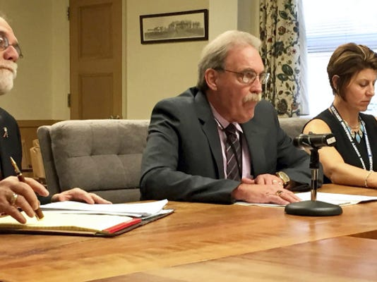 Jim Holtry (center), director of Lebanon County Children and Youth Services, explains to the Lebanon County commissioners how the agency, which includes Juvenile Probation, went over its budget by 1.3 million this year, as President John C. Tylwalk and Chief Probation Officer Sally Barry listen. John Latimer -- Lebanon Daily News