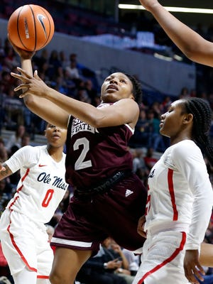 Mississippi State guard Morgan William (2) attempts a layup against Ole Miss on Sunday.