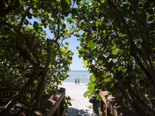 Beachgoers enjoy the private stretch of beachfront