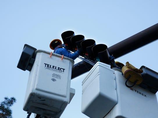 COT Traffic Signal Technicians install new flashing