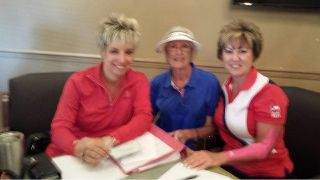 From left, Kim Lagasse, president of the Golf Association gives the good news to Toni Pope, Altrusan, and Laureen Zelt, tournament chairman.
