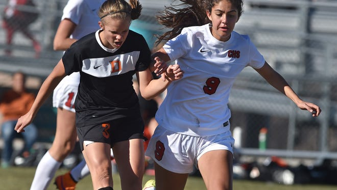 Douglas' Abby Jens, left, and Coronado's Gabrielle Casas go after ball Friday during the NIAA Division I Nevada State semi-final game at North Valleys.