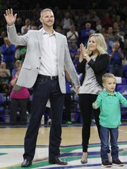 Sale, with wife Brianne and son Rylan, had his FGCU baseball jersey retired in January.