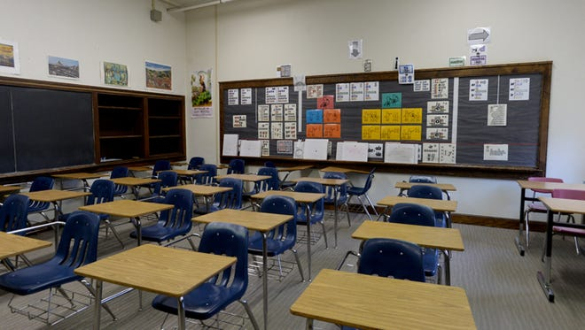 The chalkboards and shelves in this classroom at Richmond High School Friday, Sept. 11, 2015, are original to the building.